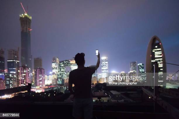 Man Using a Mobile phone in beijing cbd