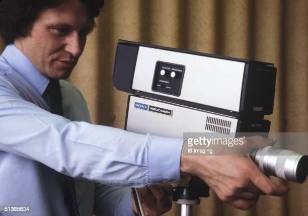 A man using a Sony video camera circa 1977