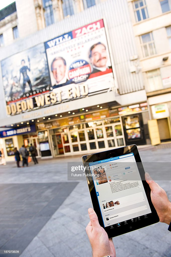 A man using an app on an iPad to read film reviews, October 4, 2012.