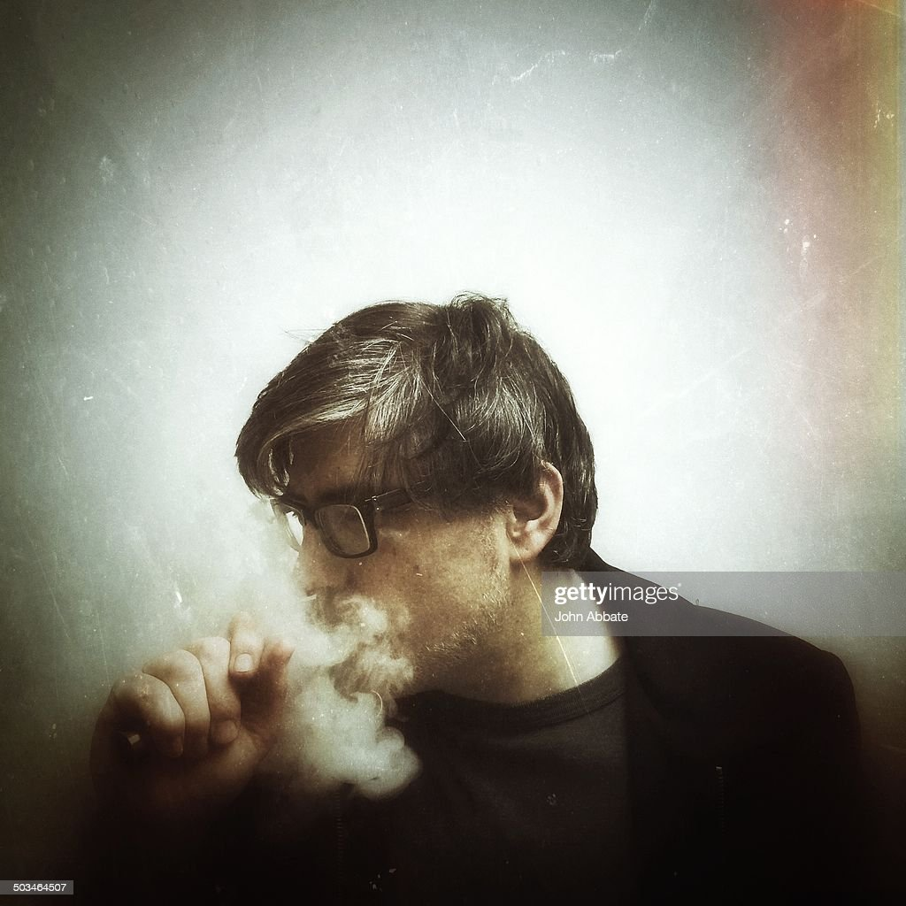 Man using an e-cigarette.