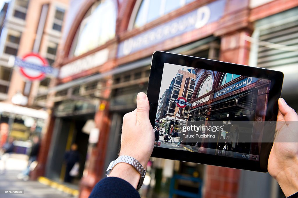 A man using an iPad to take photos in London, October 4, 2012.