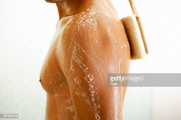 Man Using Back Scrubber