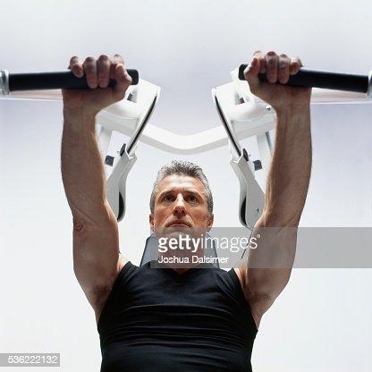Man using bench press : Stock Photo