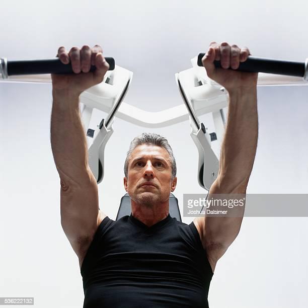 Man using bench press