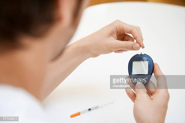 Man Using Blood Sugar Meter