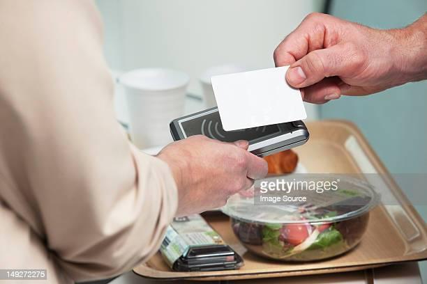 Man using card to buy food