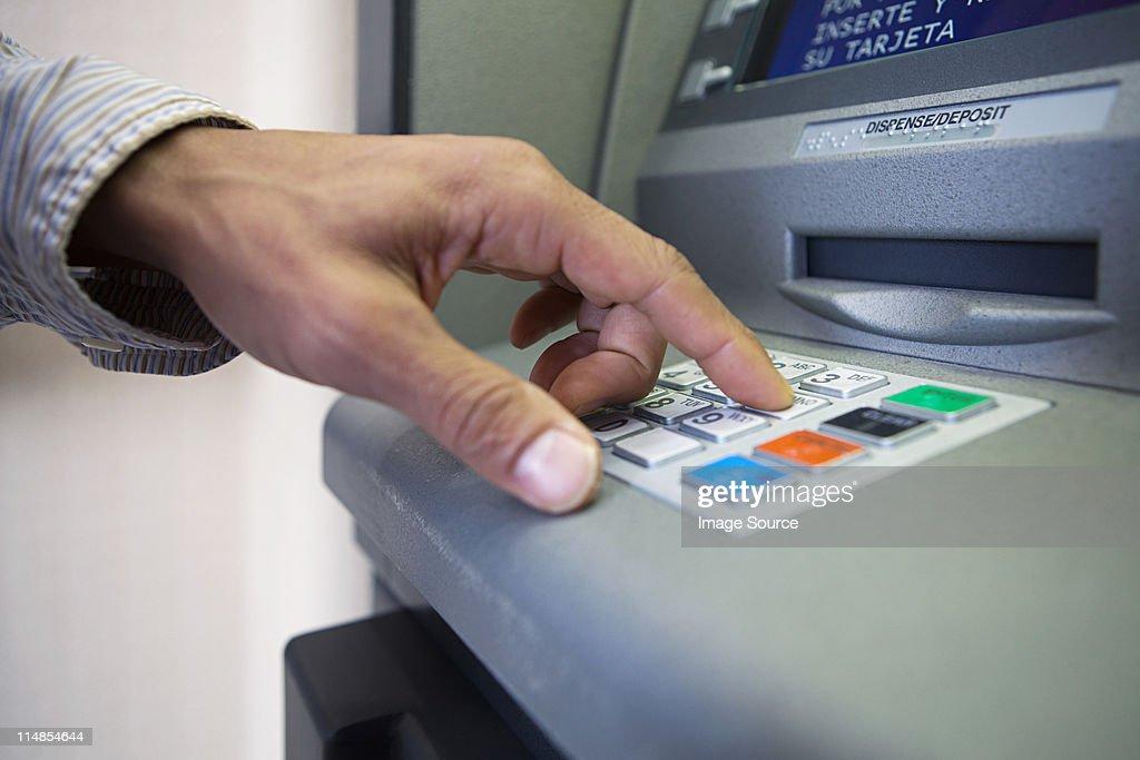 Man using cash machine, close up