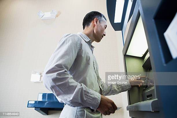 Man using cash machine
