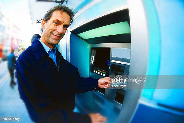 Man using cash machine, portrait