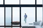 Man using cell phone on modern balcony