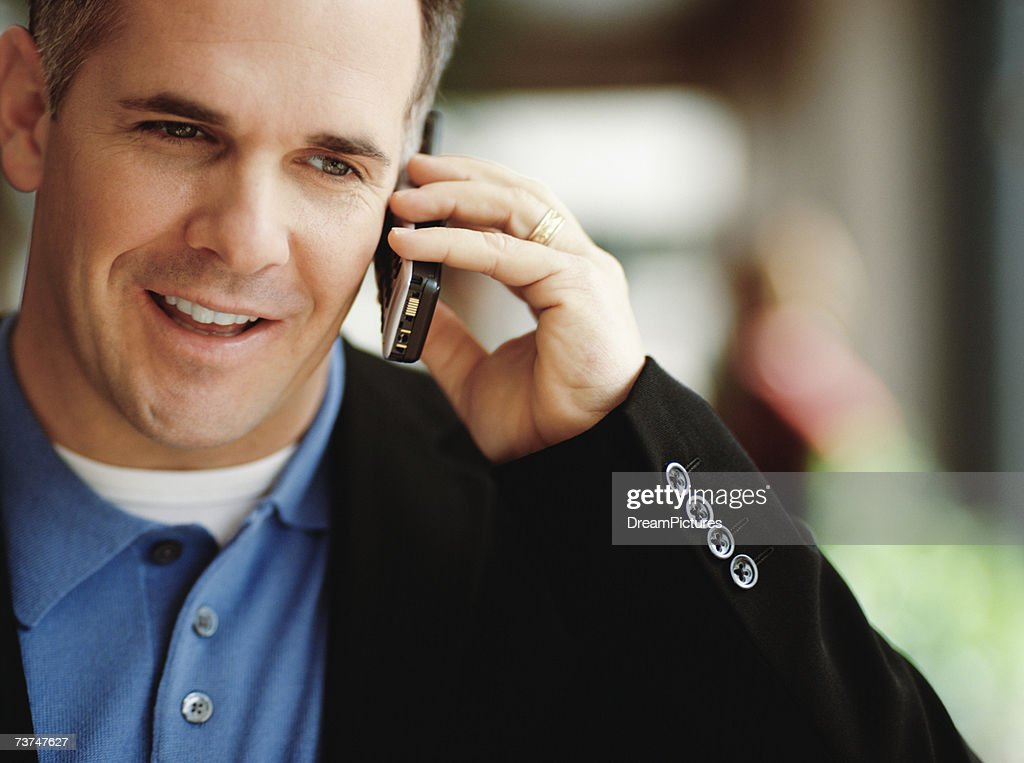 Man using cellphone, portrait : Stock Photo