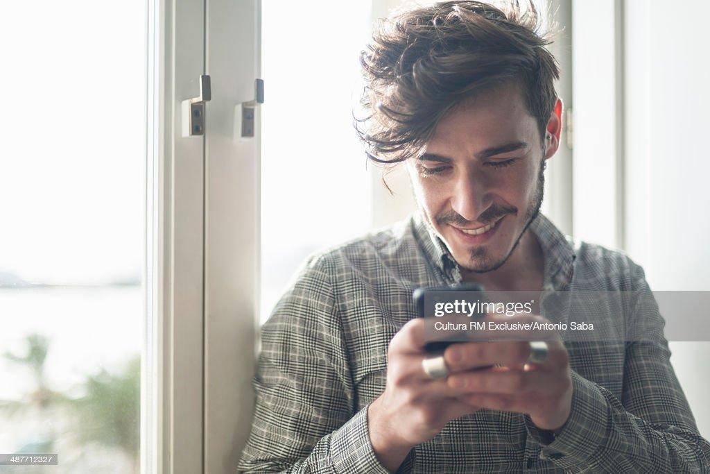 Man using cellular phone : Stock Photo