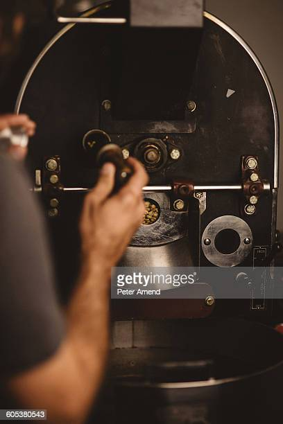 Man using coffee roaster