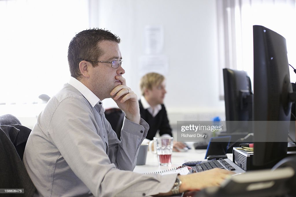 Man using computer in office : Stock Photo