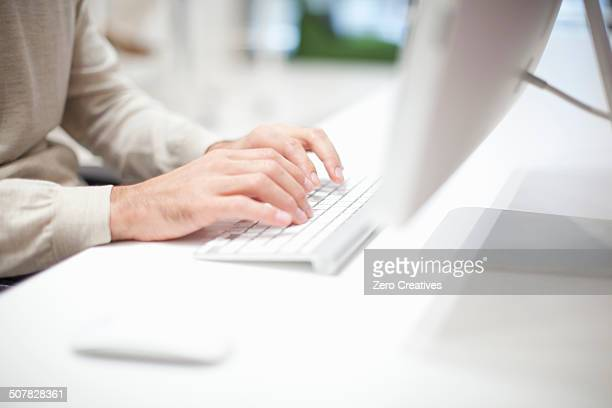 Man using computer keyboard, close up