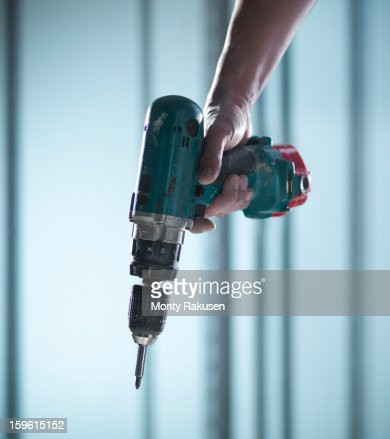 Man using cordless power drill