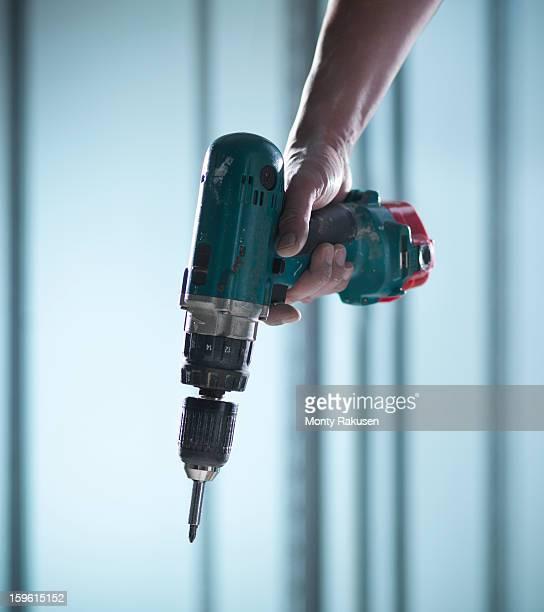Man using cordless power drill