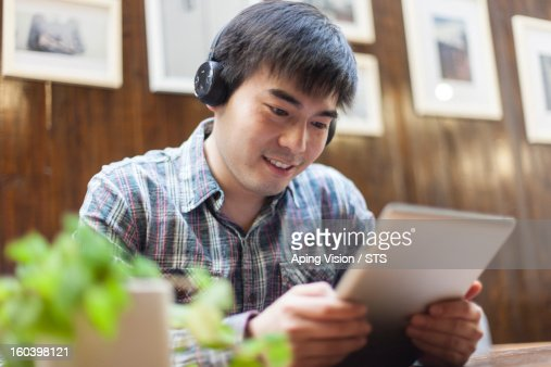 man using digital tablet in a restaurant : Stock Photo