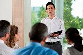 Man using digital tablet in business meeting