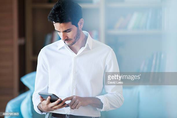 Man using digital tablet in living room