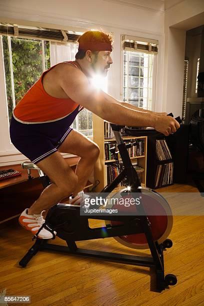 Man using exercise bike