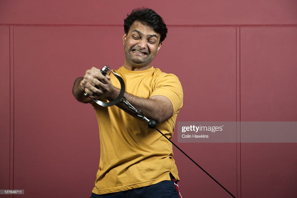 Man using exercise machine in gym