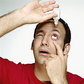 Man using eye drop, close-up