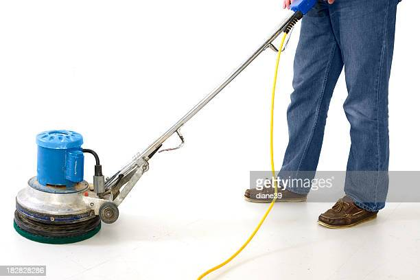 Man using floor polisher