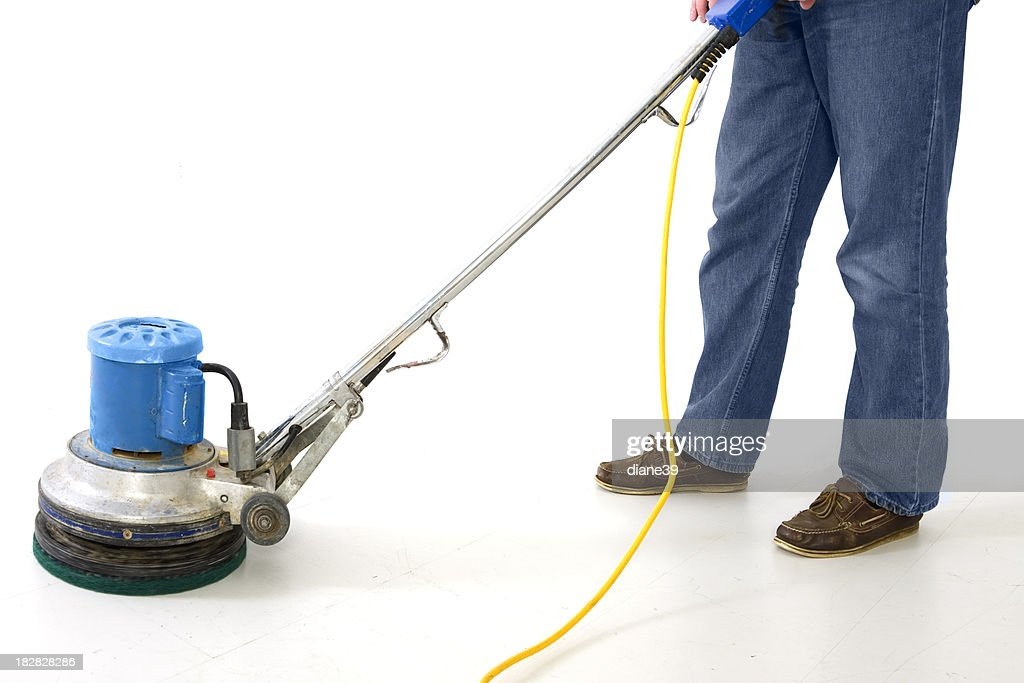 man using floor polisher