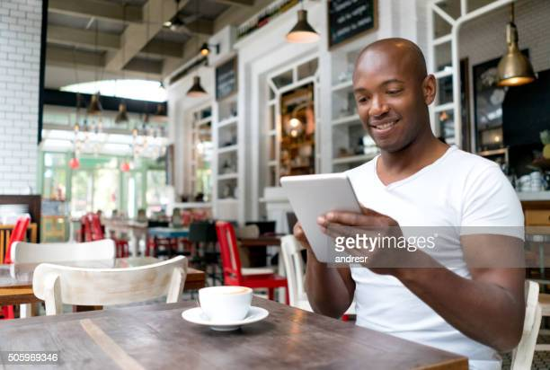 Man using free wifi at a cafe