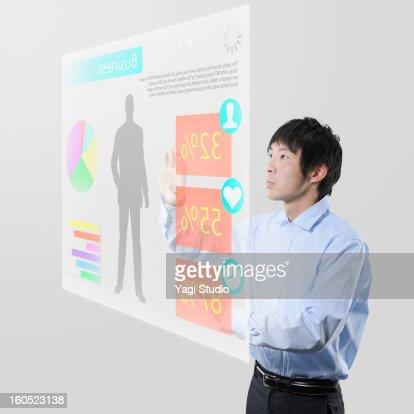 Man using Futuristic monitor : Stock Photo