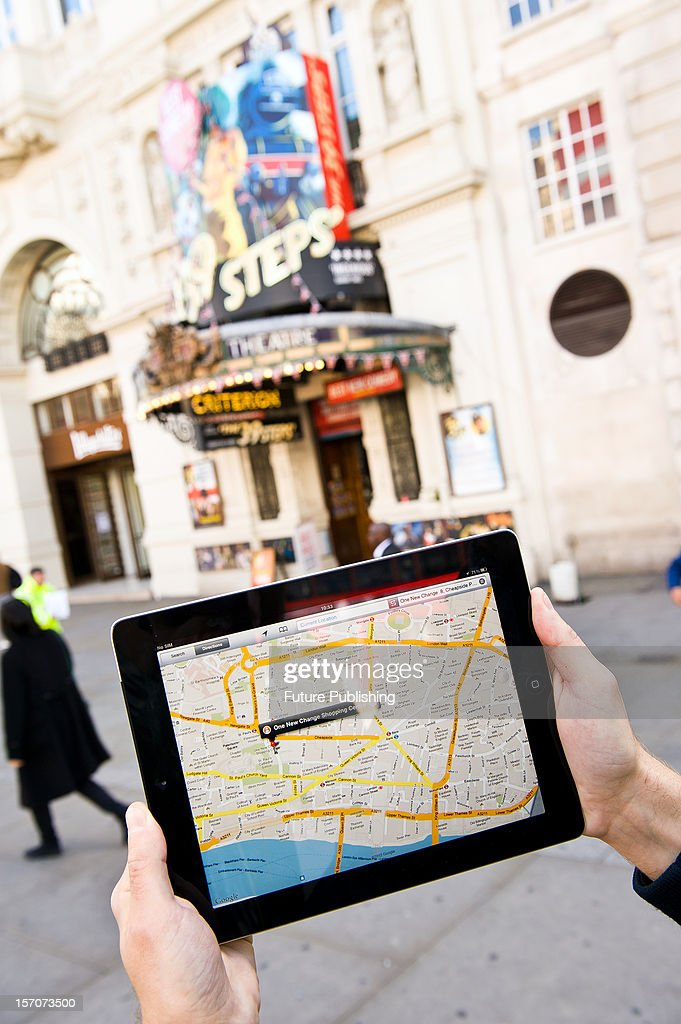 A man using Google Maps on an iPad to find his way around London, October 4, 2012.