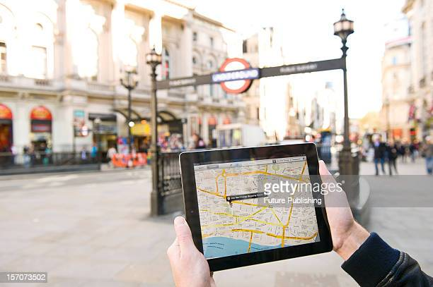 A man using Google Maps on an iPad to find his way around London October 4 2012