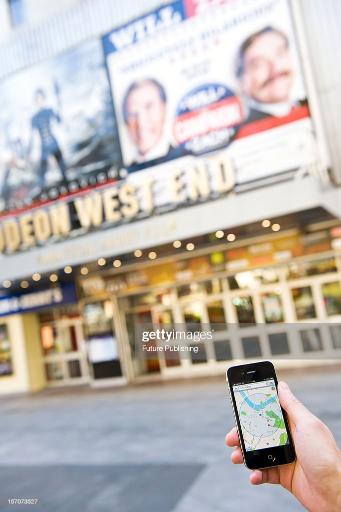 A man using Google Maps on an iPhone to find his way around London, October 4, 2012.