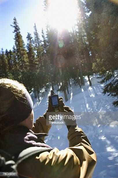 Man using GPS device in wilderness