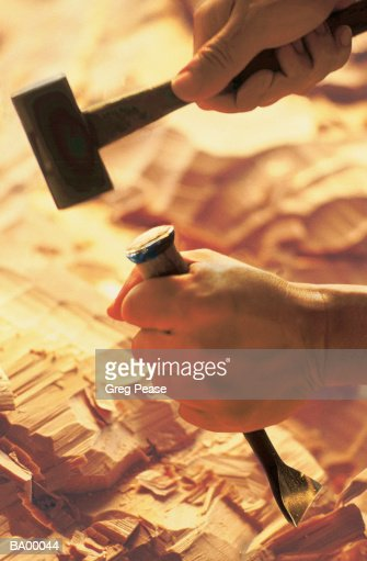[Image: man-using-hammer-and-chisel-to-sculpt-wo...?s=170667a]