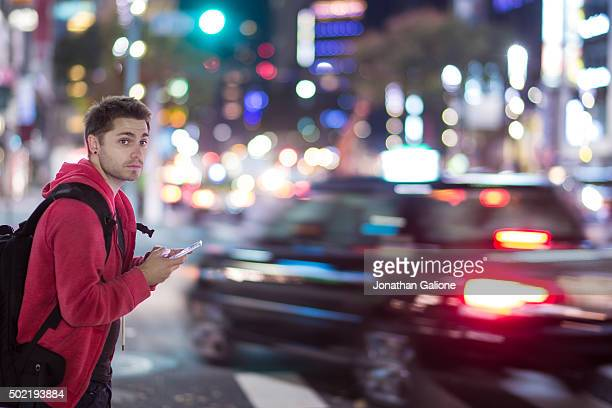 Man using his smartphone at night