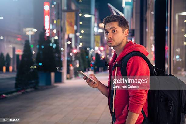 Man using his smartphone at night