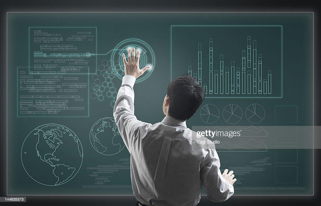 Man using hi-tech computer monitor : Stock Photo