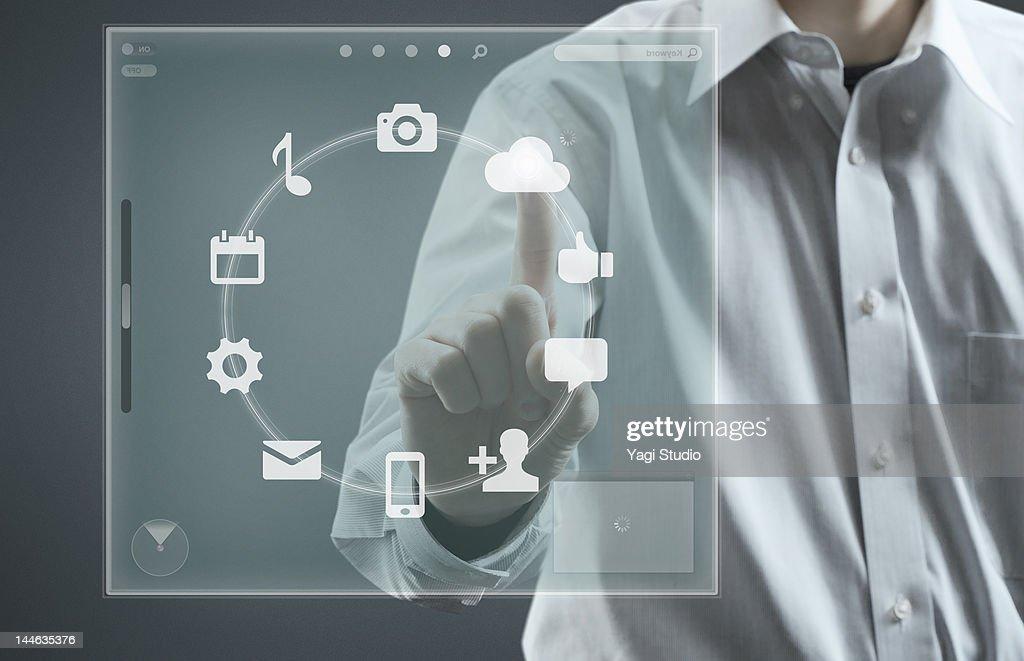 Man using hi-tech computer monitor : Foto stock