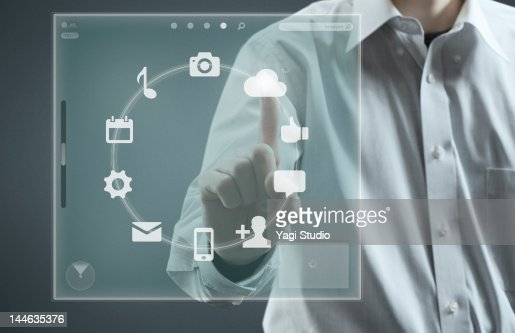 Man using hi-tech computer monitor : Stock Photo