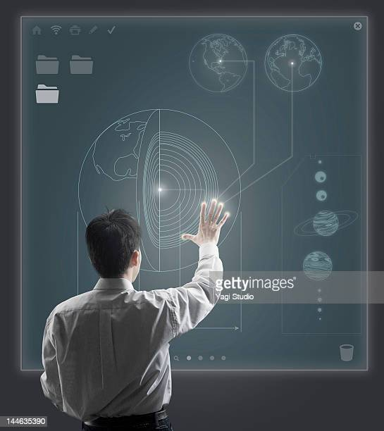 Man using hi-tech computer monitor