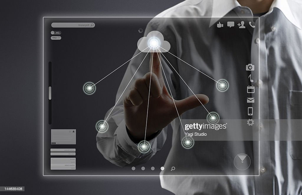 High Tech Monitor : Man using hitech computer monitor stock photo getty images