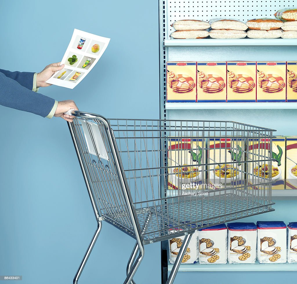 Man using images of food as as a shopping list : Stock Photo