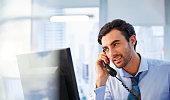 Man using landline phone in office