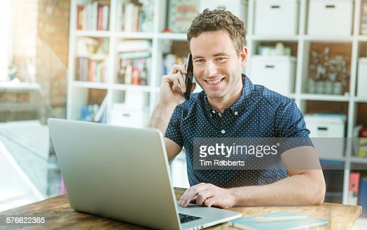 Man using laptop and smartphone