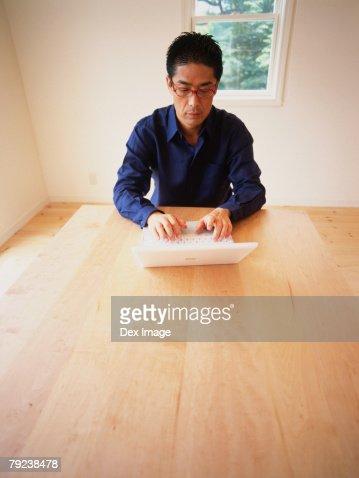 Man using laptop computer : Stock Photo