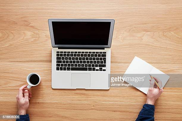 Man using laptop, directly above