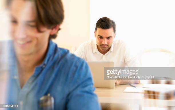 Man using laptop in office