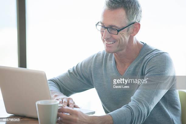 Man using laptop indoors